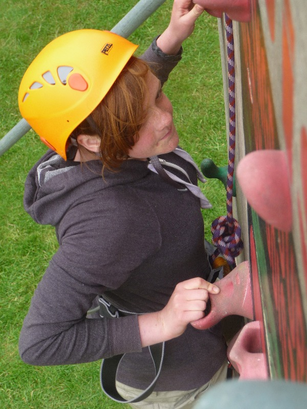 Lucy gets invested at the top of the climbing wall