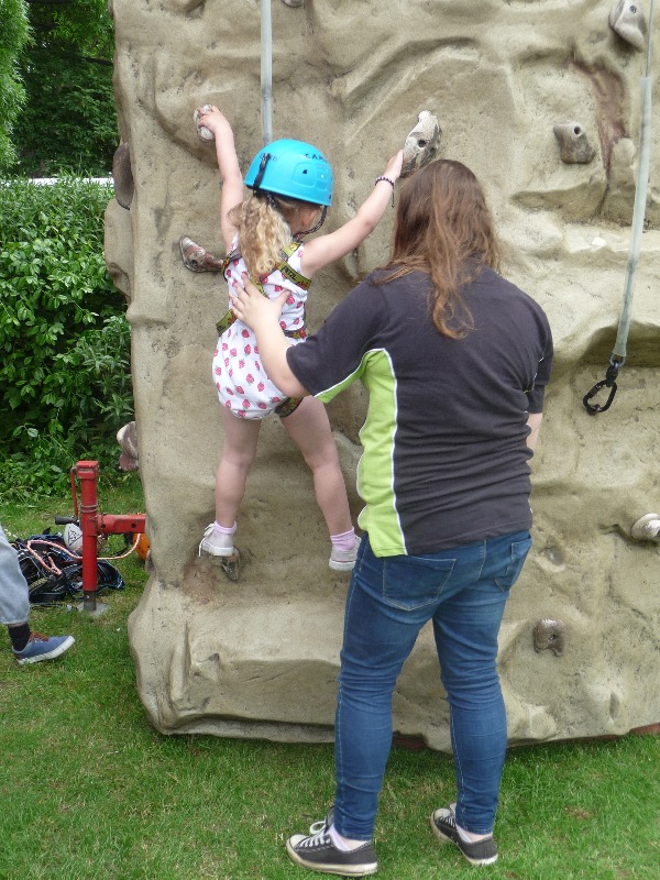 Hannah helping a young person to climb!