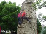 Explorers have a race on the climbing wall
